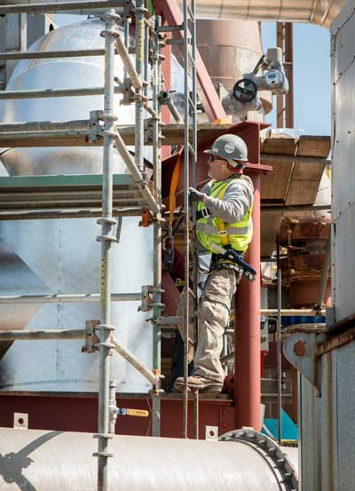 Axion Specialty Contracting Worker on ladder